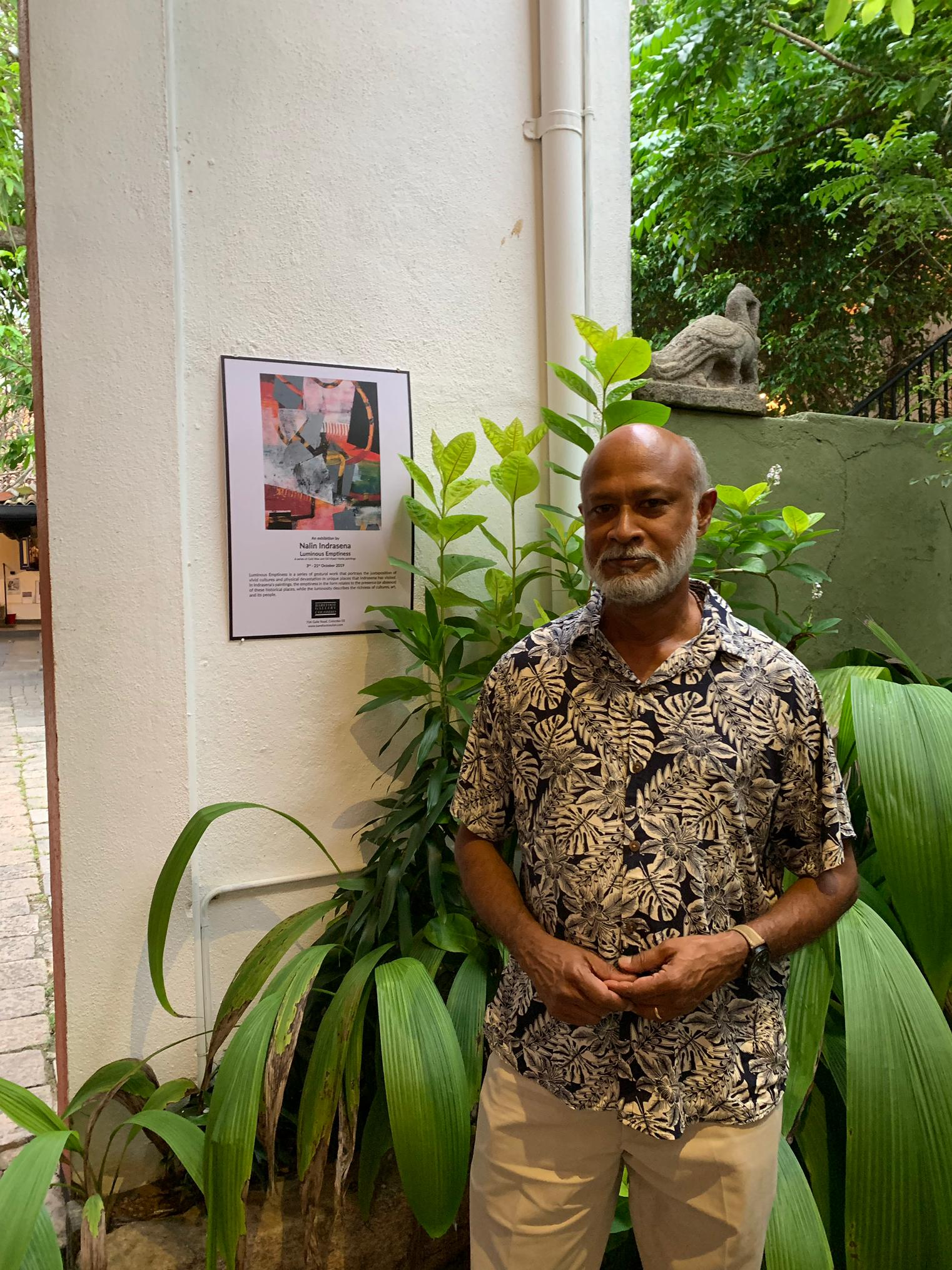 nalin at the entrance of the barfoot gallery with poster